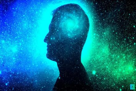 Silhouette of a man superimposed over the cosmos with the swirl of the universe where his brain would be.